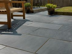 The Midnight Blue Black Riven Slate Paving Pack fully captures the timeless beauty and character of a bygone age. Its lightly riven surface makes it an ideal base for garden furniture. The deep blue / black colour tones found in Midnight Slate Slate Paving Slabs, Slate Patio, Patio Slabs, Concrete Paving, Flagstone Patio, Paving Stones, Block Paving, Paving Flags, Sandstone Slabs