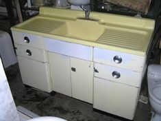 My grandmother had one of these farmhouse drainboard sinks in her kitchen. (White top.) The upper right hand drawer held the blackened paring knife that she would use to peel an apple in a single, springy piece.