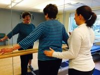 Bea Weinstein exercises with one of our fitness specialists at Orchard Cove
