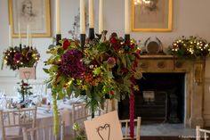 Classic deep autumnal colours on our black iron candelabra. The Wilde Bunch at North Cadbury Court Country House Wedding Venues, London Bride, Autumnal, Candelabra, Bristol, Wedding Events, Wedding Flowers, Floral Design, Christmas Tree