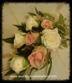white and pink spray rose corsage with blakc loop detail . www.weddingflowersbylaura.com