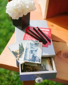 """Guests were asked to """"wish the bride and groom a world of love"""" by picking a postcard with a destination that resonated with them and writing a message to the couple"""