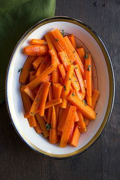 Braising carrots slowly in butter, rather than steaming or boiling them, brings out their natural sweetness. Maple syrup adds a delicate glaze and a rich flavor.