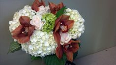 Wedding bouquet with cymbidium orchids, hydrangeas and roses. Jeanni's Garden. Com