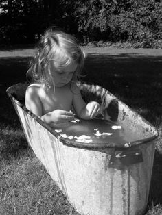 love this...how many old family photos do you have with a child in a galvanized tub outdoors?