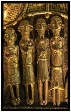 Detail from St. Manchan's Shrine, Boher, Ballycumber, County Offaly. It was made at Clonmacnois about 1130 CE, but the ornamental style is both Irish and Viking. The third happy guy clutching the axe is thought to be St.Olaf of Norway.