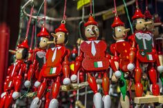 Colorful marionettes welcome the visitor to the coastal city of Amalfi, Italy.