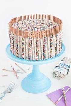 Cute and easy cake decorating! Cookies & Cream Confetti Pocky Cake | Sprinkles for Breakfast