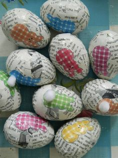 Use plastic eggs, decorate with old printed paper strips and decopauge...so cute.