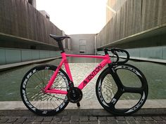 Black AVENTON MATARO Low - Pedal Room w/ hot pink frame & tri-spoke F wheel