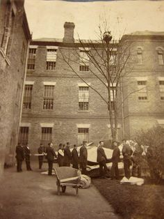 The team at a psychiatric hospital waiting for a patient to climb or jump down from a tree, Colney Hatch Asylum, London - 1895 Old Hospital, Abandoned Hospital, Hospital Photos, Abandoned Asylums, Abandoned Places, Old Pictures, Old Photos, Insane Asylum Patients, Mental Asylum