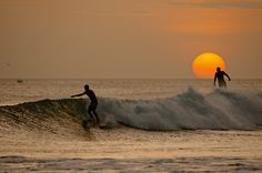 """On this evening in Nicaragua the sun just seemed to hover above the horizon,"" says Chris. ""Muted by a slight haze, the sun still gave just enough light for Dan Malloy enjoy his last few waves before fading away completely."" Photo: Burkard"