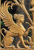 winged sphinx on gate