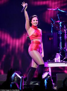 Scintillating: The 23-year-old singer looked fabulous in a red leather two-piece top and high-waisted shorts combination