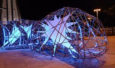 a parametrically generated organic lattice structure created from split bamboo rods, interwoven fabric panels, and an interactive LED lighting system. Macau, Architecture Student, Architecture Design, Bamboo Roof, Bamboo Building, Temporary Structures, Stage Set, Exhibition Space, St Joseph