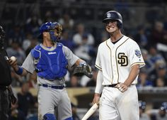 Wil Myers Photos Photos - Wil Myers #4 of the San Diego Padres grimaces after taking a strike during the ninth inning of a baseball game against the Los Angeles Dodgers on opening day at PETCO Park on April 4, 2016 in San Diego, California. The Dodgers won 15-0. - Los Angeles Dodgers v San Diego Padres