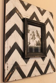 Paint chevron onto wood, put a picture frame in the middle and distress! Love the idea for the living room!