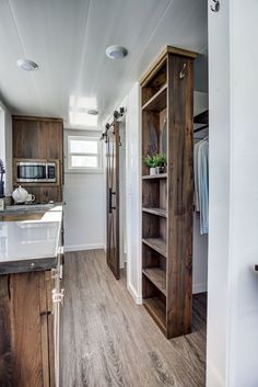 This is the Cocoa Tiny House on Wheels by Modern Tiny Living. Its Cocoa time! With stunning wood throughout stainless steel countertops modern black hardware and tons of storage Cocoa ma Tiny House Big Living, Best Tiny House, Modern Tiny House, Tiny House Plans, Tiny House Design, Tiny House On Wheels, Tiny House Storage, Smart Storage, Tiny House Closet
