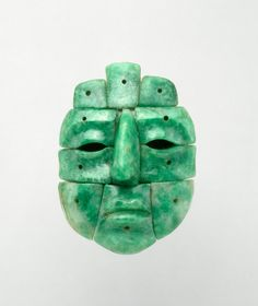 Miniature Mosaic Mask 600-900 Maya, Mexico or Guatemala 700 - 1000 Jade 2 x 1.5 x .75 in. 5.08 x 3.81 x 1.91 cm. Read more at http://vmfa.museum/collections/art/miniature-mosaic-mask/#Ou0M3oF6P8jf34oO.99