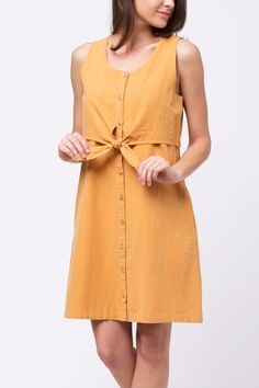 Button down yellow dress with layered top and little front knot detail. Double Layered Top Dress by Movint. Tie Front Dress, Button Down Dress, Crop Image, First Day Of Summer, Girls Dresses, Summer Dresses, Yellow Dress, Betsey Johnson, Best Sellers