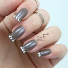 Dotted French Manicure feat. Cadillacquerhttp://lucysstash.com/2014/07/dotted-french-manicure-feat-cadillacquer.html