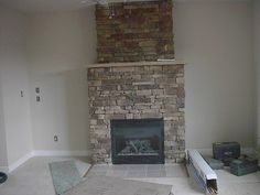 Gas fireplace in home. By Village Craft Iron & Stone, Inc.
