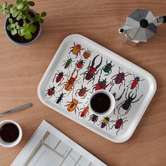 Bug breakfast tray made from Scandinavian birch featuring beetles and exotic creepy crawlies from all over the world! Illustrated by James Barker