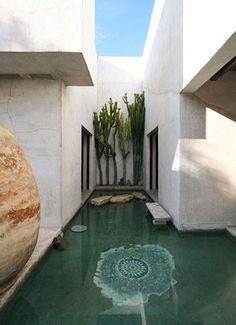 application of water indoor. water/the green x cactus x stones x rocks [Moroccan interior design of Philip Dixon]