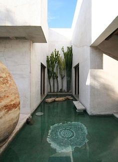 application of water indoor. water/the green x cactus x stones x rocks [Moroccan interior design of Philip Dixon]