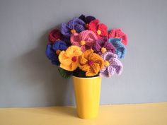 Pinwheel flowers free knitting pattern | Flower Knitting Patterns, many free patterns at http://intheloopknitting.com/free-flower-knitting-patterns/