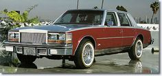 This 1977 Cadillac Seville, two-tone burgundy and silver with white leather interior was the last Cadillac that Elvis ever purchased. Today the car is owned by Greg Page. -