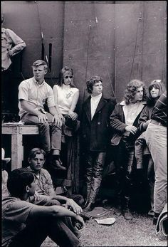 A very young Jim Morrison. To Jim's left is the man who designed all Jim's leathers & outfits. This is backstage before a show,.