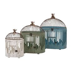 Elaine Bird Houses - Set of 3 - I know why the caged bird sings: A trio of pretty decorative birdhouses imbue a garden space with color and a sense of harmony.