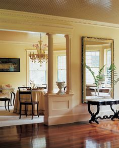Love the posts and woodwork, and the lovely warm color.