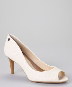 Looking for a sleek twist on your heels? TheseSnake Leather Kasia Pumps in ivory just may do the trick! By Calvin Klein on #zulily! #zulilyfinds