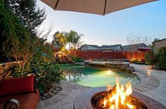 Brick, Tile, Fire Pit, Awning, Pool with Hot Tub