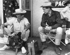 News Photo : Arthur Miller talks with Clark Gable on the set...