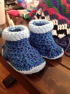 Custom booties lion brand yarn contact me for a pair !
