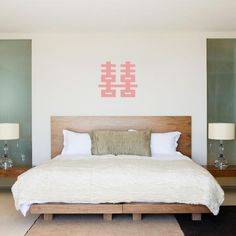Ejemplos de dormitorios con buen feng shui | LoveToKnow Wall Sticker, Wall Decals, Wall Vinyl, Fen Shui, Feng Shui Bedroom, Removable Wall, Vinyl Lettering, Bedroom Wall, Furniture