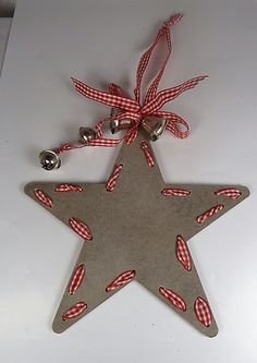 A GREY WOOD CHRISTMAS STAR HANGING DECORATION WITH BELLS: