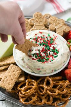 This Christmas cookie dough dip has a fluffy and creamy Chobani Greek Yogurt base that's swirled with plenty of holiday sprinkles and served with fruit and cookies for dipping. It only takes 5 minutes to make! #HolidayWithChobani Ad