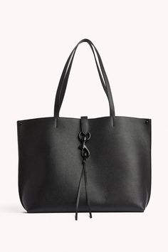 Style This bag is not eligible for the current promotion. Leather Black hardware X X 1 Exterior back slide pocket 1 Interior back slide pocket Magnetic snap closure Unlined Imported Rebecca Minkoff Tote, Rebecca Minkoff Handbags, Black Leather Tote Bag, Pebbled Leather, Shopper Tote, Black Purses, Cloth Bags, Womens Tote Bags, Dog Clip