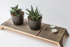 Made of reclaimed white cedar from a dismantled Brooklyn rooftop water tower. Would be lovely as a plant stand, laptop tray or a place to display small goodies.