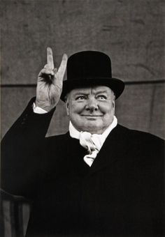 WINSTON CHURCHILL GIVING HIS TWO FINGERED BOWMEN OF AGINCOURT SIGN. . THE HOKEY POKEY MAN AND AN INSANE HAWKER OF FISH BY CONNIE DURAND, NOW AVAILABLE ON AMAZON KINDLE