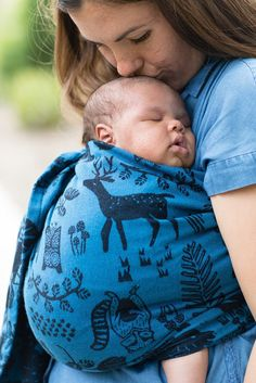 Woodland nursery ring sling. Woodland Sapphire - Cotton Ring Sling. Woodland nursery ring sling. Woodland Sapphire - Cotton Ring Sling. Set out into the world with baby in tow and see what you can find! 'Woodland Sapphire' is decorated with enchanted flora and fauna found in a woodsy setting in vibrant blue and black.