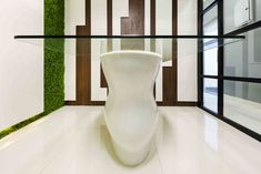 The meeting room houses a sleek curve shaped corian table by A.J Architects. Corian, Architects, Houses, Shapes, Contemporary, Interior Design, Table, Room, Homes