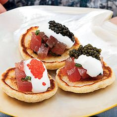 CAVIAR.  Tuna Tartare Blini  Try it with: Champagne, sparkling wine.  I can think of nothing else I'd rather drink with this divine combination of melt-in-your-mouth tuna and caviar than a good bubbly.