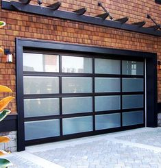 Clean lines, aluminum frame, and translucent glass panels make a Modern Classic garage door, from Northwest Door and available at Oregon City Garage Door ...