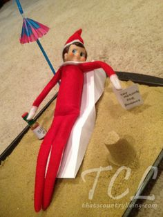 Creative Elf on the Shelf ideas:  Mini beach. Relaxing in this warmer climate. Every where is warmer than the North Pole.