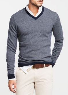 navy blue v-neck cotton sweater. white oxford. khaki pants. brown leather belt. comfortable. casual. style.